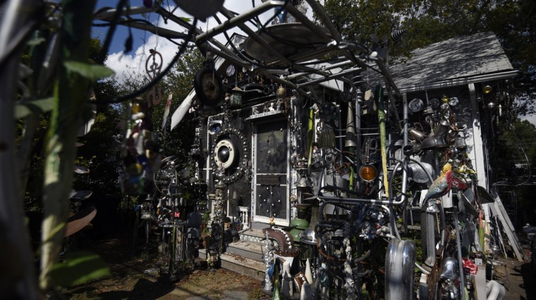 "Artist A. Clarke Bedford creates sculptures on and around his Hyattsville home from found objects. The retired art conservator at the Hirshhorn Museum, says the assemblage is ""a curious desire and compulsion, but it's something I think is very nourishing.""  (Kim Hairston/Baltimore Sun)"