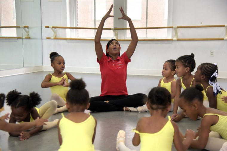 Falisha Massey demonstrates creative movement exercises for students. (Algerina Perna/Baltimore Sun)