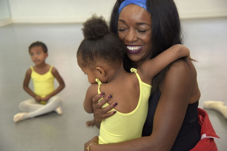 "Sharayna A. Christmas Rose, founder of Rayn Fall Dance Studio, is hugged by Zuri Richardson, 3, in the creative movement class. According to the Rayn Fall Dance Studio brochure, the class is, ""specifically structured to bring the joy of music and movement to young children."" Christmas Rose founded RFDS in 2004 as one of the programs of Muse 360 Arts. The dance program's mission is to, ""provide people of diverse backgrounds with an opportunity to receive training in dance while receiving exposure in the allied arts."" Children from ages 3 to 22 participate in the classes in African, ballet, creative movement, Hip Hop, modern, pre-dance, tap and jazz dance. The Studio offers both a community program and a professional training program for ages 8-21.(Algerina Perna/Baltimore Sun)"