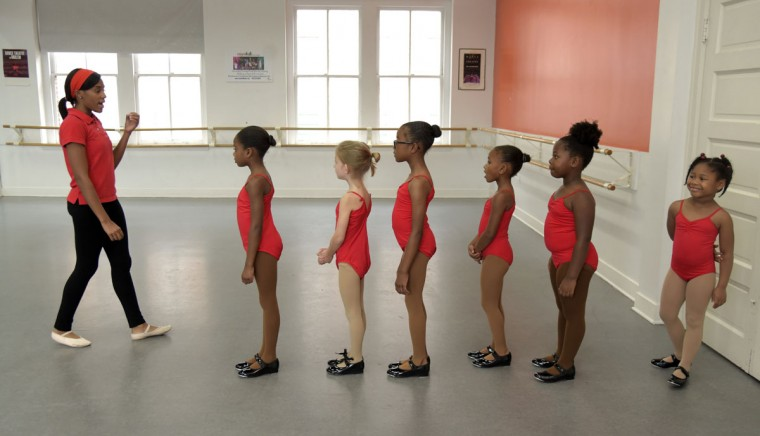 In the pre-dance class, Falisha Massey, left, teaches the basics of tap to students from left: Chloe Lee, 7; Nola Regan, 6; London Westlyn, 7; Madison Morgan, 5; Arielle Jones, 5, and Kyla Jones, 5. (Algerina Perna/Baltimore Sun)