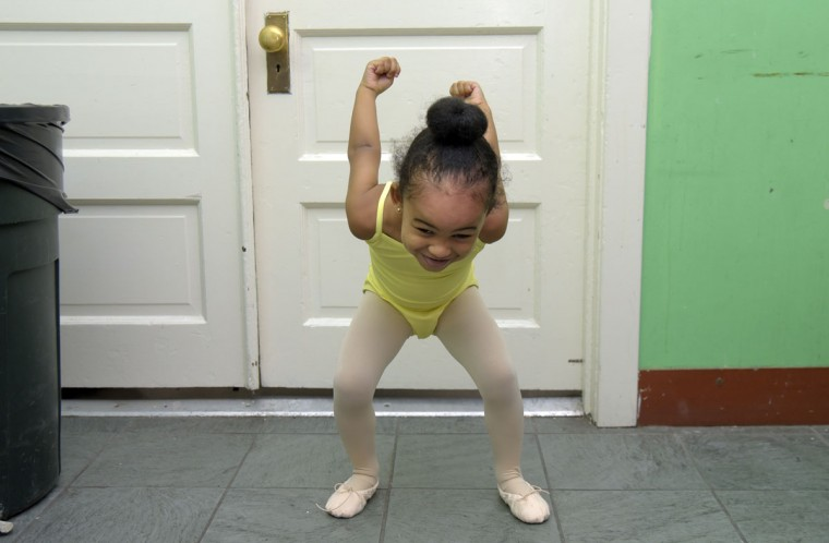 "Drew Washington, 3, stretches enthusiastically before taking the creative movement class. According to the Rayn Fall Dance Studio brochure, the class is, ""specifically structured to bring the joy of music and movement to young children."" (Algerina Perna/Baltimore Sun)"