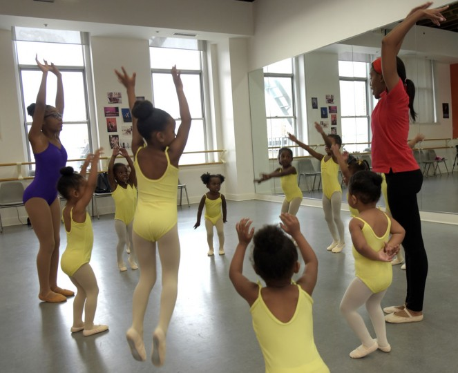 Dance instructor Falisha Massey, right, and Level IV student helper Naima Eggleston, 11, far left, instruct students in the creative movement class where shortly, they will float like butterflies. (Algerina Perna/Baltimore Sun)