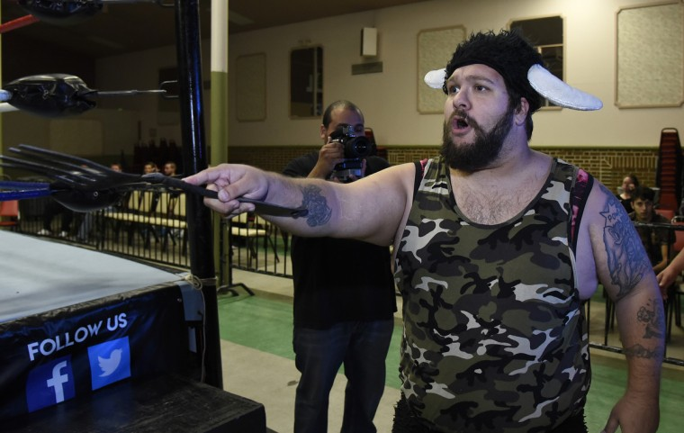 "Wrestler ""Blood"" taunts his opponent from outside the ring at the EWA ""Last Rites"" professional wrestling match that was held at Tall Cedars Hall. (Barbara Haddock Taylor/Baltimore Sun)"