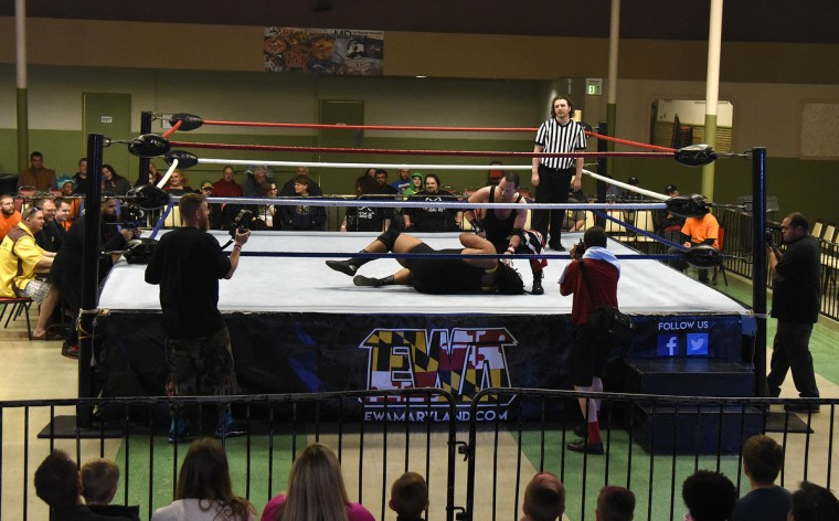 "Chris Burns (top) and Jai Kole wrestle in the opening match at the EWA ""Last Rites"" professional wrestling match that was held at Tall Cedars Hall. (Barbara Haddock Taylor/Baltimore Sun)"