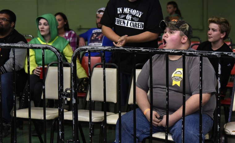 "Brandon Crites, right, a 14 year old fan, cheers during a match at the EWA ""Last Rites"" professional wrestling match that was held at Tall Cedars Hall. (Barbara Haddock Taylor/Baltimore Sun)"