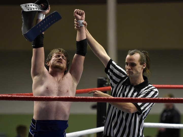 "Wrestler Wes Mercer raises his arms in victory at the EWA (Eastern Wrestling Association) ""Last Rites"" professional wrestling match that was held at Tall Cedars Hall. (Barbara Haddock Taylor/Baltimore Sun)"