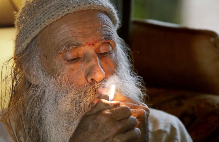"In this Thursday, Oct. 13, 2016 photo, Swami Chaitanya lights a ""grower's joint"" marijuana cigarette at his home near Laytonville, Calif. Chaitanya and his wife, Nikki Lastreto, who grow their ""Swami's Select"" medical marijuana, support the passage of Proposition 64, the Nov. 8 ballot initiative, which would legalize the recreational use of marijuana. (AP Photo/Rich Pedroncelli)"