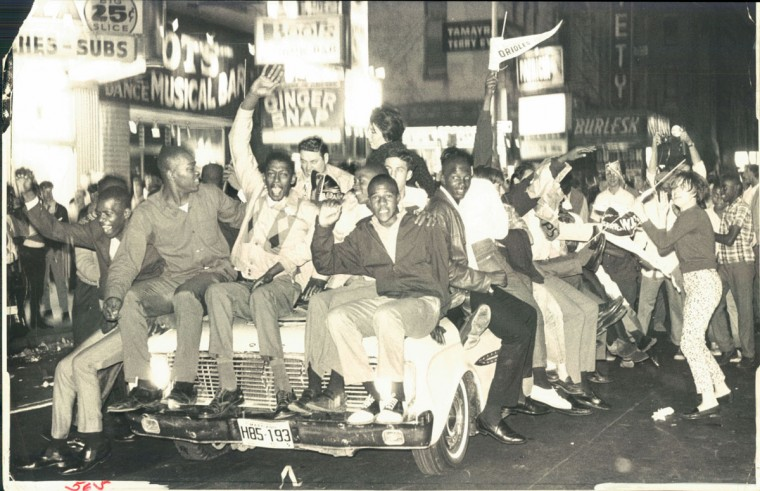 October 10, 1966 - ON THE BAND WAGON -- Everybody wanted part of the action on West Baltimore street last night as the downtown erupted in wild celebration following the Orioles' fourth straight victory. These victory riders push through the crowded Block area. (William L. LaForce / Baltimore Sun)