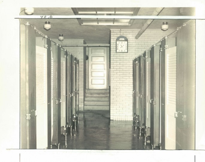 "Inside a public bath house, photo dated 1939. Users were restricted to a 20-minute shower, and there were plenty of signs on the tiled walls governing conduct: ""Anyone caught taking towels belonging to the bath commission will be prosecuted by law;"" Unnecessary noise prohibited;"" ""No smoking;"" and ""No shaving."" (Baltimore Sun)"
