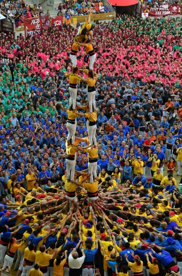 "Members of the ""Bordegassos de Vilanova"" human tower team form a ""castell"" during the XXVI human towers, or castells, competetion in Tarragona on October 1, 2016.   These human towers, built traditionally in festivals within Catalonia, gather several teams that attempt to build and dismantle a tower structure. (LLUIS GENE/AFP/Getty Images)"