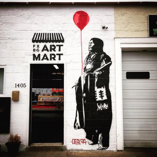 """The act of representation doesn't come without its problems, says muralist Gregg Deal. In Baltimore and in other cities, large artworks by well-known muralists may help renew interest in a depressed neighborhood -- and in turn help catalyze the process of gentrifying. """"What sucks about that is as an artist, you're trying to make a living and do well,"""" Deal says. """"And then you know you ran into this moral dilemma of painting murals in spaces that are gonna displace – where people are gonna be displaced, and you might have a contribution to that."""" (Photo courtesy of the artist)"""