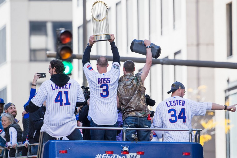John Lackey #41, David Ross #3, Travis Wood #37 and Jon Lester #34 of the Chicago Cubs celebrate during the 2016 World Series victory parade on November 4, 2016 in Chicago, Illinois. The Cubs won their first World Series championship in 108 years after defeating the Cleveland Indians 8-7 in Game 7. (Photo by Tasos Katopodis/Getty Images)