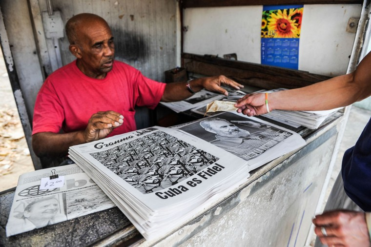 A man sells newspapers in Havana, on November 27, 2016, two days after Cuban leader Fidel Castro died. Cuban revolutionary icon Fidel Castro died late November 25 in Havana, his brother, President Raul Castro, announced on national television. Castro's ashes will be buried in the historic southeastern city of Santiago on December 4 after a four-day procession through the country. (AFP PHOTO/YAMIL LAGE)