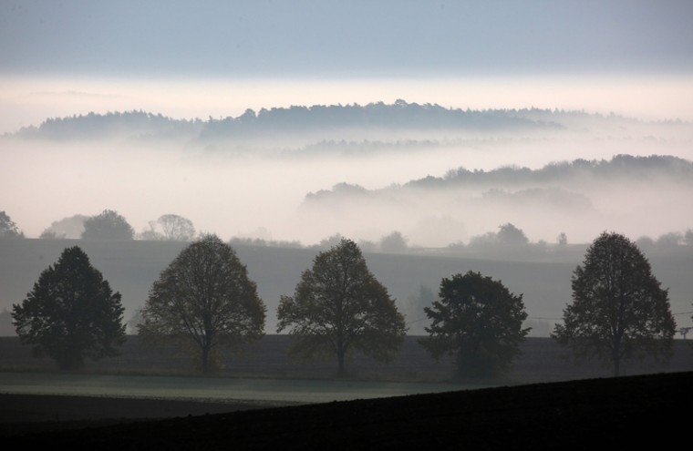 Fog covers fields and forests near Tolzin, northern Germany, on October 26, 2016. (BERND WUSTNECK/AFP/Getty Images)