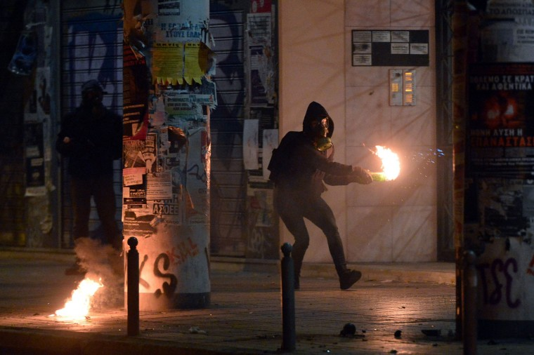 A protester throws a molotov cocktail during clashes around the Polytechnic school, following a protest against the visit of the US president in Athens on November 15, 2016. US President Barack Obama is in Greece on a two-day official visit. (Louisa Gouliamaki/AFP/Getty Images)