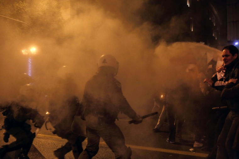 Tear gas is used as protesters clash with riot police during a demonstration against the visit of the US president around the Polytechnic school in Athens on November 15, 2016. US President Barack Obama is in Greece on a two-day official visit. (Angelos Tzortzinis/AFP/Getty Images)
