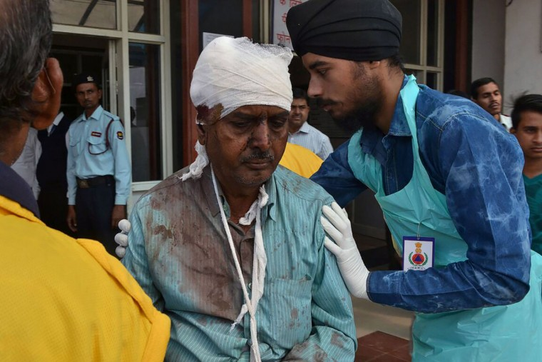 An injured Indian passenger is treated at a hospital in Kanpur on November 20, 2016 after a deadly train derailment. A passenger train derailed in northern India on November 20, killing at least 63 travellers most of whom were sleeping when the fatal accident occurred, police said. Rescue workers rushed to the scene near Kanpur in Uttar Pradesh state where the Patna-Indore express train derailed in the early hours of the morning. (AFP PHOTO /Getty Images)