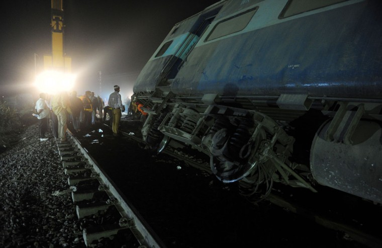 Rescue workers operate at the site of a derailed train near Pukhrayan in Kanpur district on November 20, 2016. Emergency workers raced to find any more survivors in the mangled wreckage of an Indian train that derailed on November 20, killing at least 120 people, in the worst disaster to hit the country's ageing rail network in recent years. Shocked passengers recalled being jolted out of their early morning slumber by a violent thud as 14 carriages leapt from the tracks in a remote area near Kanpur city in Uttar Pradesh state. (AFP PHOTO / SANJAY KANOJIA)