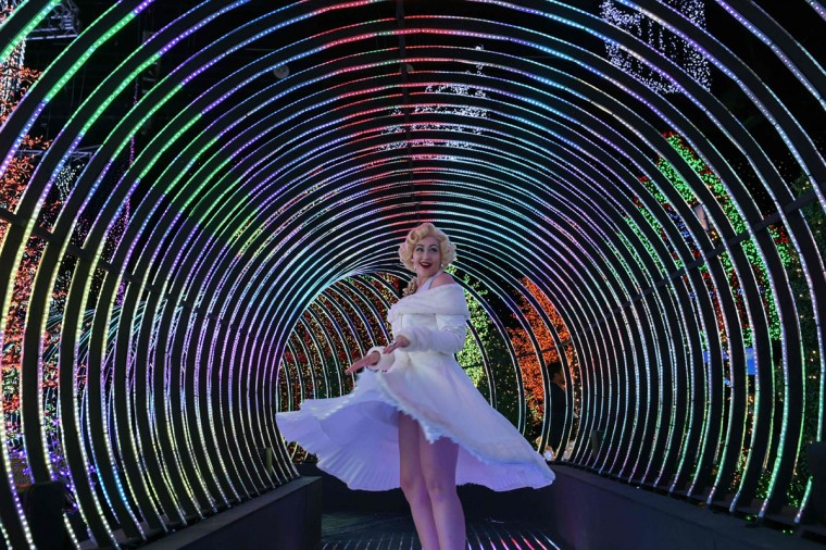 A Marilyn Monroe impersonator poses inside the Universal Journey during a media preview of Santa's All-Star Christmas at Universal Studios Singapore in Resorts World Sentosa on November 17, 2016. Singapore's Universal Studio broke the Guinness World Record for having the largest indoor display of lightbulbs with 824,961 bulbs in a festive light display separated into eight thematic zones. (ROSLAN RAHMAN/AFP/Getty Images)