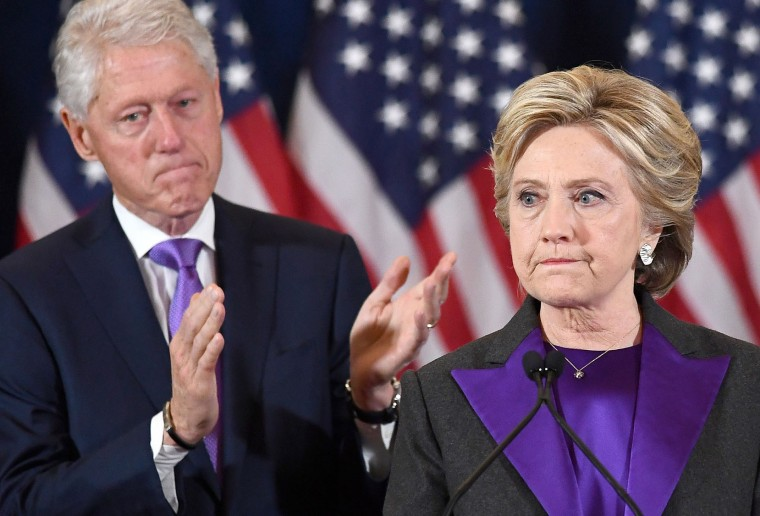 US Democratic presidential candidate Hillary Clinton makes a concession speech after being defeated by Republican President-elect Donald Trump, as former President Bill Clinton looks on in New York on November 9, 2016. (Jewel Samad/AFP/Getty Images)