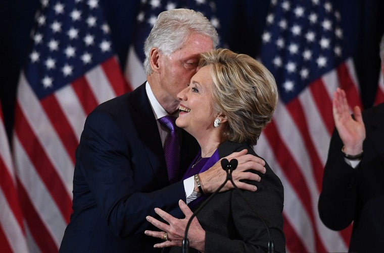 US Democratic presidential candidate Hillary Clinton is embraced by former president Billl Clinton after making a concession speech following her defeat to Republican President-elect Donald Trump, in New York on November 9, 2016. (Jewel Samad/AFP/Getty Images)