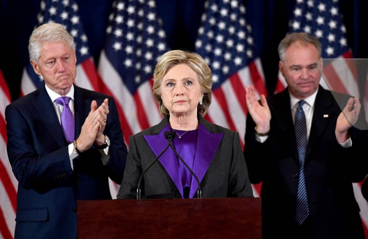 US Democratic presidential candidate Hillary Clinton makes a concession speech after being defeated by Republican presidential-elect Donald Trump as her running-mate Tim Kaine (R) and former president Bill Clinton look on in New York on November 9, 2016. (Jewel Samad/AFP/Getty Images)