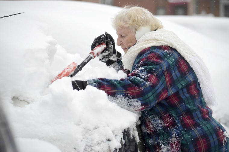 "Lorraine Amato digs out her car at Columbus Towers in Pittsfield, Mass., Monday, Nov. 21, 2016, after the region got hit with more than 10 inches of snow, according to The Berkshire Eagle. ""We knew it was snowing last night, but didn't expect this,"" said Amato. (Ben Garver/The Berkshire Eagle via AP)"