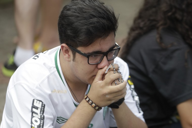 A fan of Brazil's soccer team Chapecoense mourns outside the Arena Conda stadium in Chapeco, Brazil, Tuesday, Nov. 29, 2016. A chartered plane that was carrying the Brazilian soccer team to the biggest match of its history crashed into a Colombian hillside and broke into pieces, Colombian officials said Tuesday. (AP Photo/Andre Penner)