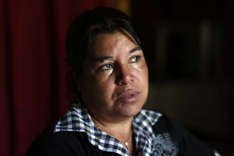 """In this Oct. 22, 2016 photo, Juana Poblete cries as she talks about her daughter, Lissette, who died under the care of the Chilean state, in Til Til, Chile. The former head of the National Service for Minors later said that Lisette died because she was """"conflictive."""" But a police investigation has shown that the child's caretakers were partly responsible for her death and failed to administer the CPR that could have saved her life. (AP Photo/Luis Hidalgo)."""