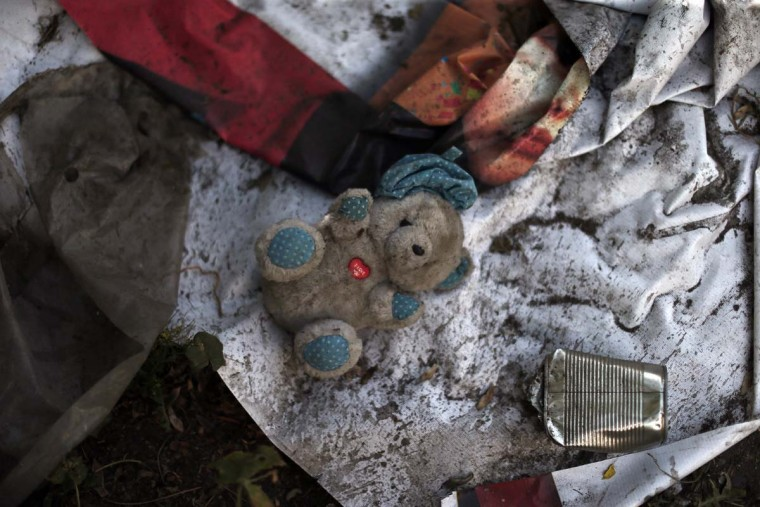 In this Oct. 10, 2016 photo, trash, dirty blankets and a toy lay in a ruined building inhabited by street children in Santiago, Chile. Many if not all of the youths living in the ruin were once wards of the state, living in shelters of National Service for Minors. (AP Photo/Luis Hidalgo)