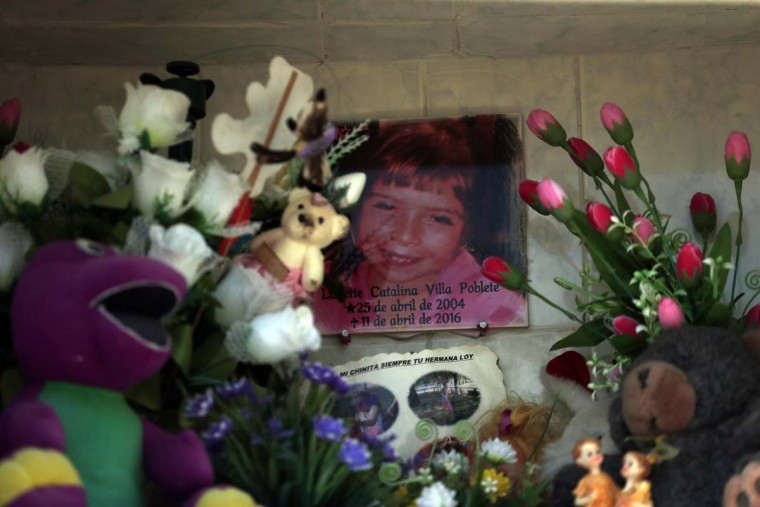 """In this Oct. 22, 2016 photo, the photo of Lissette decorates her tomb in Til Til, Chile. Lissette died under the care of the Chilean state, suffocating in her own vomit while a caretaker allegedly sat on her back while trying to contain the 11-year-old during what was described as """"a crisis of aggressiveness."""" (AP Photo/Luis Hidalgo)"""