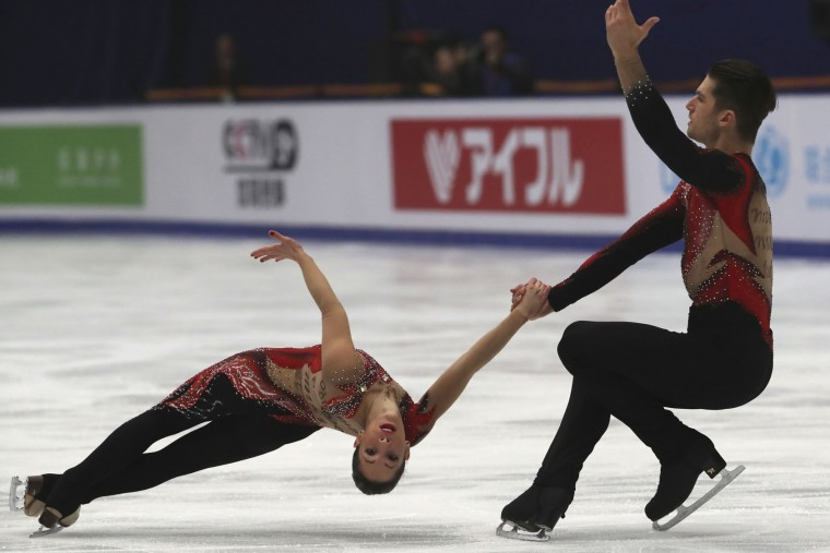 Nicole Della Monica and Matteo Guarise of Italy compete in the Pairs Short Program during the Audi Cup of China ISU Grand Prix of Figure Skating 2016 held in Beijing's Capital Gymnasium on Friday, Nov. 18, 2016. (AP Photo/Ng Han Guan)