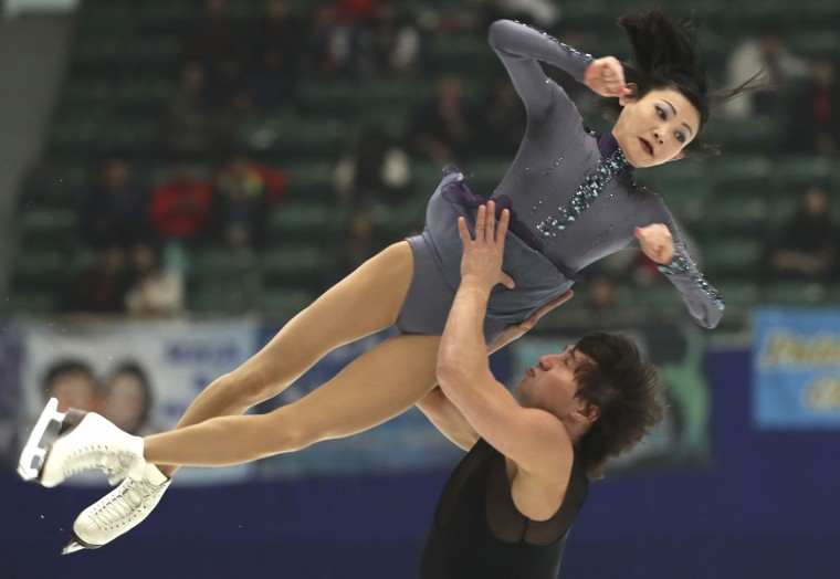 Yuko Kavaguti and Alexander Smirnov of Russia compete in the Pairs Short Program during the Audi Cup of China ISU Grand Prix of Figure Skating 2016 held in Beijing's Capital Gymnasium on Friday, Nov. 18, 2016. (AP Photo/Ng Han Guan)