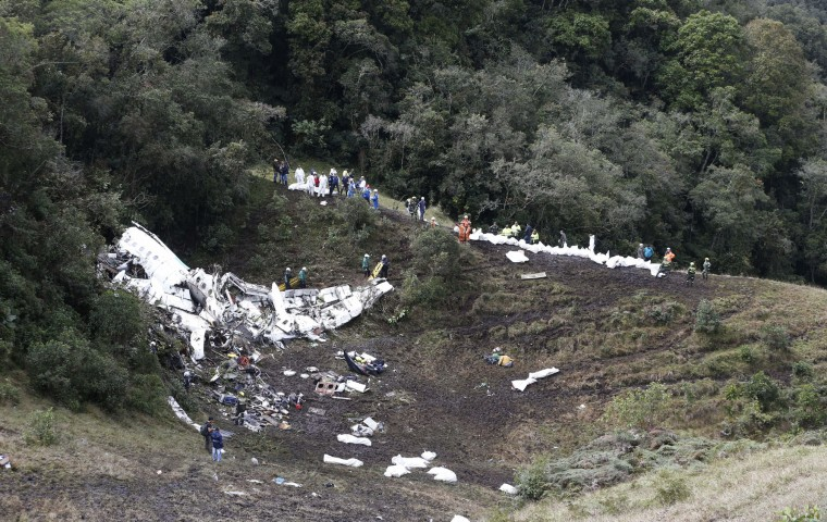 Rescue workers arrange for evacuation of the bodies of victims of an airplane that crashed in La Union, a mountainous area near Medellin, Colombia, Tuesday, Nov. 29, 2016. The plane was carrying the Brazilian first division soccer club Chapecoense team that was on it's way for a Copa Sudamericana final match against Colombia's Atletico Nacional. (AP Photo/Fernando Vergara)