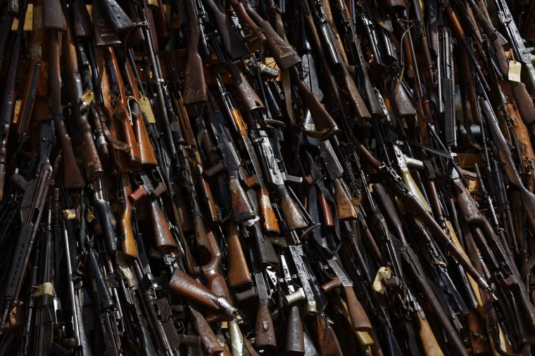 A pile of 5,250 illegal weapons before they were burned by Kenyan police in Ngong, near Nairobi, in Kenya Tuesday, Nov. 15, 2016. The weapons consisted of both confiscated and surrendered firearms that had been stockpiled over almost a decade and were destroyed by police as a message to the public to surrender others. (AP Photo/Ben Curtis)