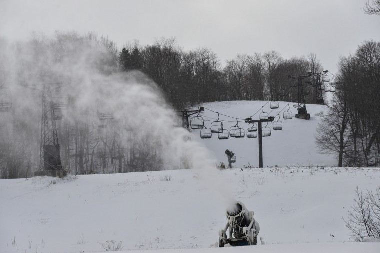 Crews at Mt. Snow, in Dover, Vt., use snow guns to make snow on Monday, Nov. 21, 2016 as they plan to open mid-week. New England ski areas are rejoicing in the recent snow ahead of the traditional start to the season. (Kristopher Radder/Brattleboro Reformer via AP)