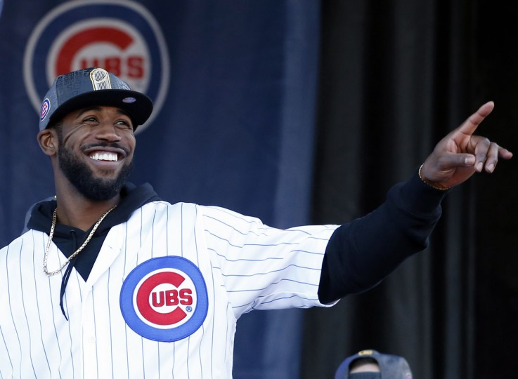 Chicago Cubs' Dexter Fowler smiles as he points during a celebration honoring the World Series champions at Grant Park in Chicago, Friday, Nov. 4, 2016. (AP Photo/Nam Y. Huh)