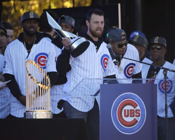 Chicago Cubs Ben Zobrist holds up the World Series MVP trophy and addresses the crowd during a celebration in Grant Park honoring the World Series baseball champions Friday, Nov. 4, 2016, in Chicago. (AP Photo/Charles Rex Arbogast)
