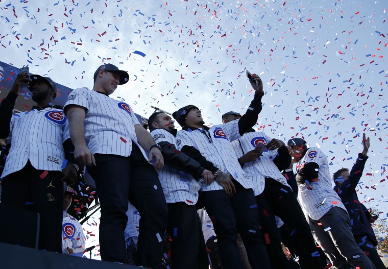 Chicago cubs players celebrate during a rally honoring the World Series champions at Grant Park in Chicago, Friday, Nov. 4, 2016. (AP Photo/Nam Y. Huh)