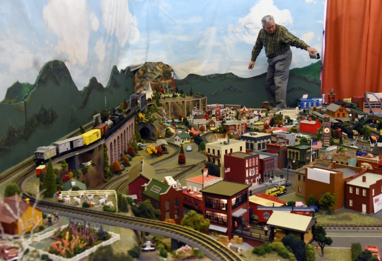 John Palese, a volunteer at The Fire Museum of Maryland, works on the museum's annual train garden.  (Kim Hairston/Baltimore Sun)