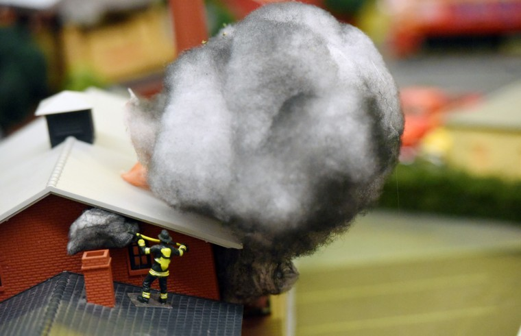 Detail of firefighter working at a warehouse fire. The scene was built by Holton Brown, a board member and volunteer at The Fire Museum of Maryland. (Kim Hairston/Baltimore Sun)