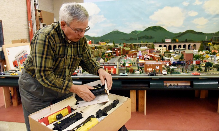 John Palese, a volunteer at The Fire Museum of Maryland, unpacks a Lionel steam locomotive as he works on the museum's annual train garden. Many local businesses and landmarks are represented in the model railroad display that opens on November 26.  (Kim Hairston/Baltimore Sun) (Kim Hairston/Baltimore Sun)