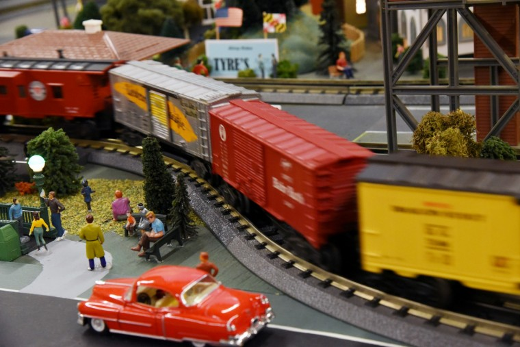 A model train passes by a subway entrance in the town created for The Fire Museum of Maryland's annual train garden. Visitors will be able to see six sets of O-Guage Lionel trains running when the display opens on November 26.  (Kim Hairston/Baltimore Sun)