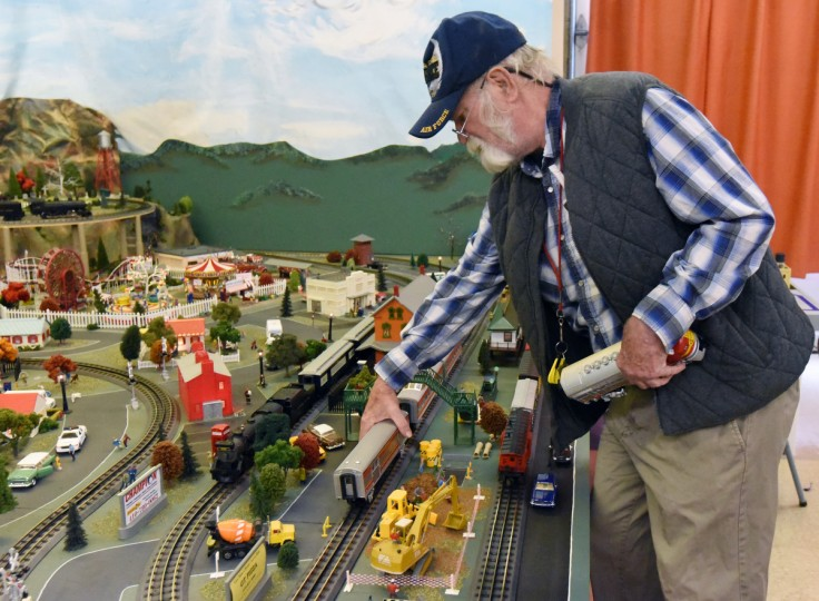 Holton Brown, a board member and volunteer at The Fire Museum of Maryland, works on the museum's annual train garden.  Many local businesses and landmarks are represented in the model railroad display that opens on November 26.  (Kim Hairston/Baltimore Sun)