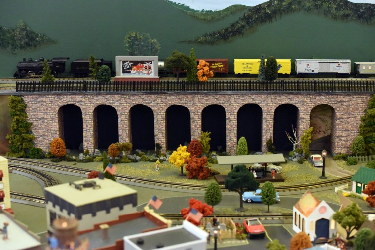 "A train crosses the eight arches of a model of the Thomas Viaduct.  Named for Philip E. Thomas, the first president of the B&O Railroad and finished in 1835, the viaduct is ""the world's oldest multiple stone arched railroad bridge"" as listed on Maryland's National Register Properties.  Many local businesses and landmarks are represented in The Fire Museum of Maryland's annual train garden that opens on November 26.  (Kim Hairston/Baltimore Sun)"