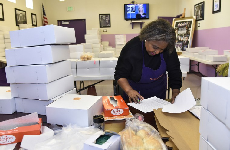 Susan Dezern puts orders together in the back room at The Avenue Bakery. (Barbara Haddock Taylor/Baltimore Sun)