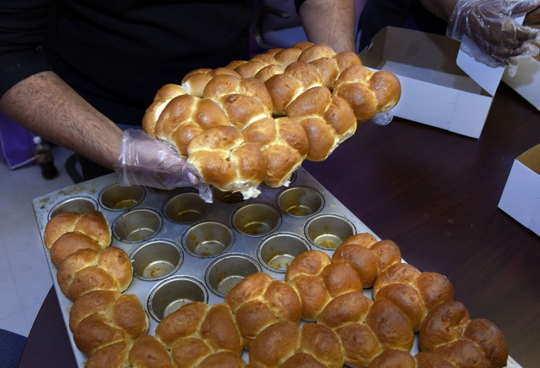 Wheat dinner rolls are ready to be boxed at The Avenue Bakery. (Barbara Haddock Taylor/Baltimore Sun)