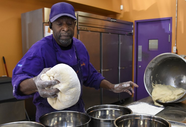 "James Hamlin, owner of The Avenue Bakery, separates dough for his famous ""Poppay's"" dinner rolls. (Barbara Haddock Taylor/Baltimore Sun)"