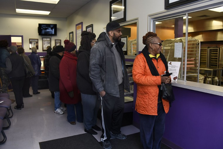 """Customers line up in the lobby of The Avenue Bakery in hopes of getting some of the bakery's famous """"Poppay's"""" dinner rolls in time for the holiday. (Barbara Haddock Taylor/Baltimore Sun)"""