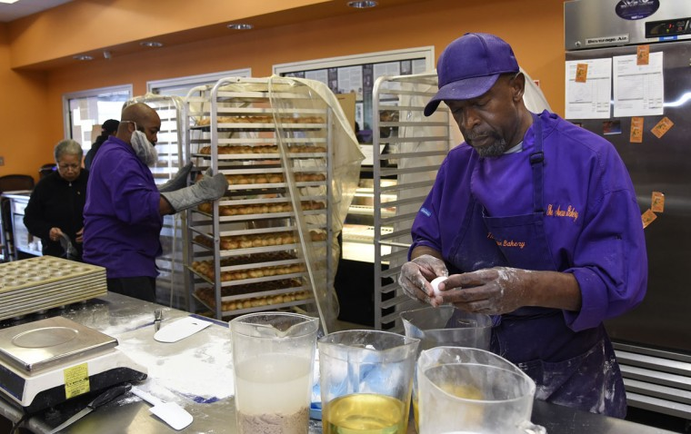 "Owner James W. Hamlin, right, cracks eggs for his famous ""Poppay's"" dinner rolls at The Avenue Bakery. (Barbara Haddock Taylor/Baltimore Sun)"